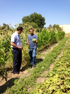 Program Assistant, Felipe Perez (right) Leading A Garden Tour